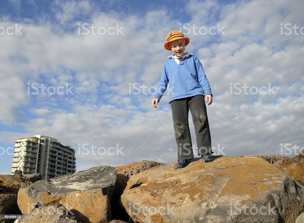 Child Standing on Rocks royalty-free stock photo
