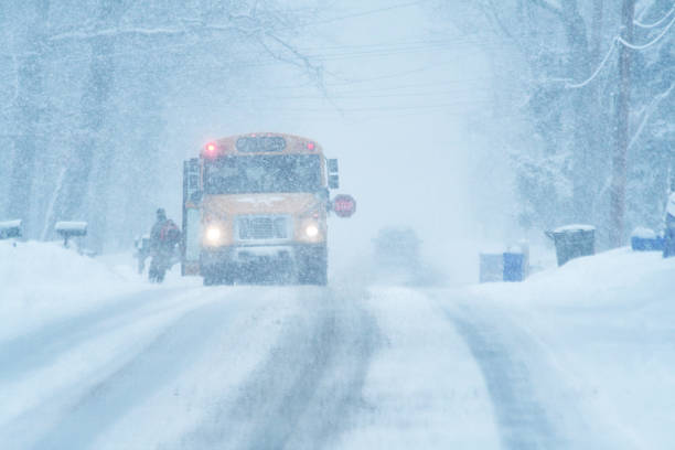 child student running to school bus in blizzard snow storm - extreme weather stock pictures, royalty-free photos & images