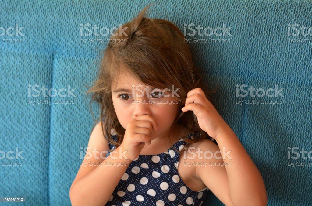 Child sucks thumb stock photo