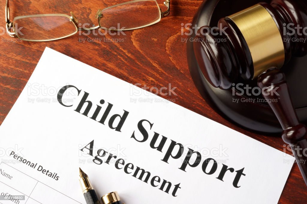 Child support agreement on an office table. stock photo