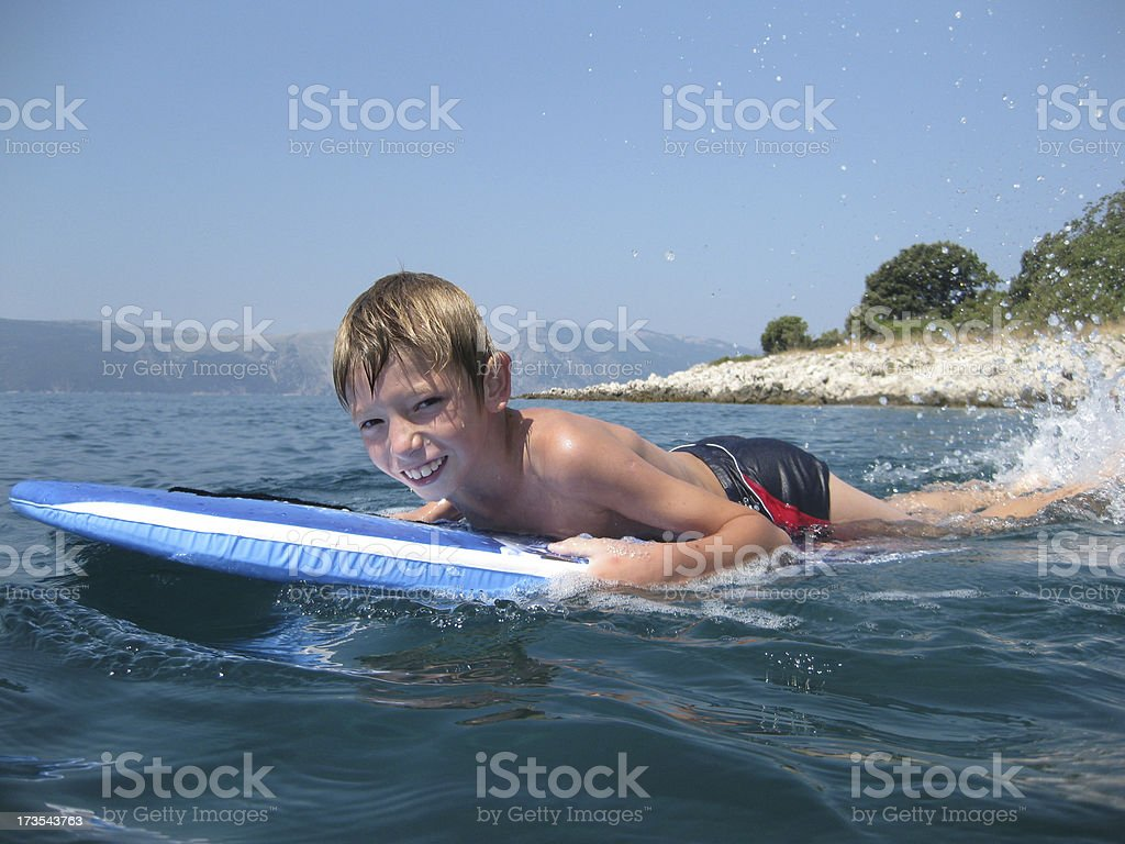Child surfing royalty-free stock photo