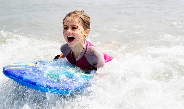 Child surfing stock photo