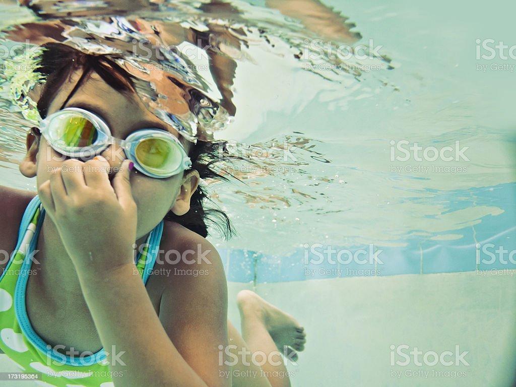 child swimming underwater stock photo