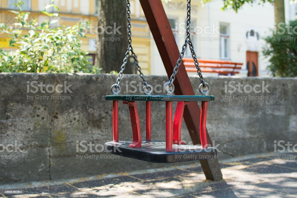 Child swing in a park stock photo