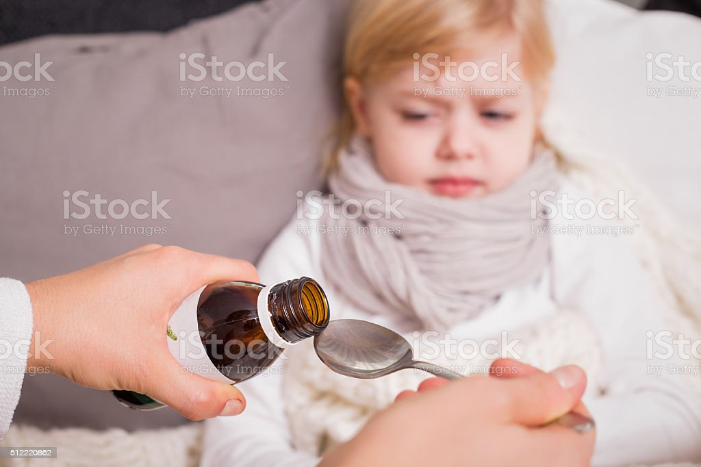 Child takig medicine stock photo