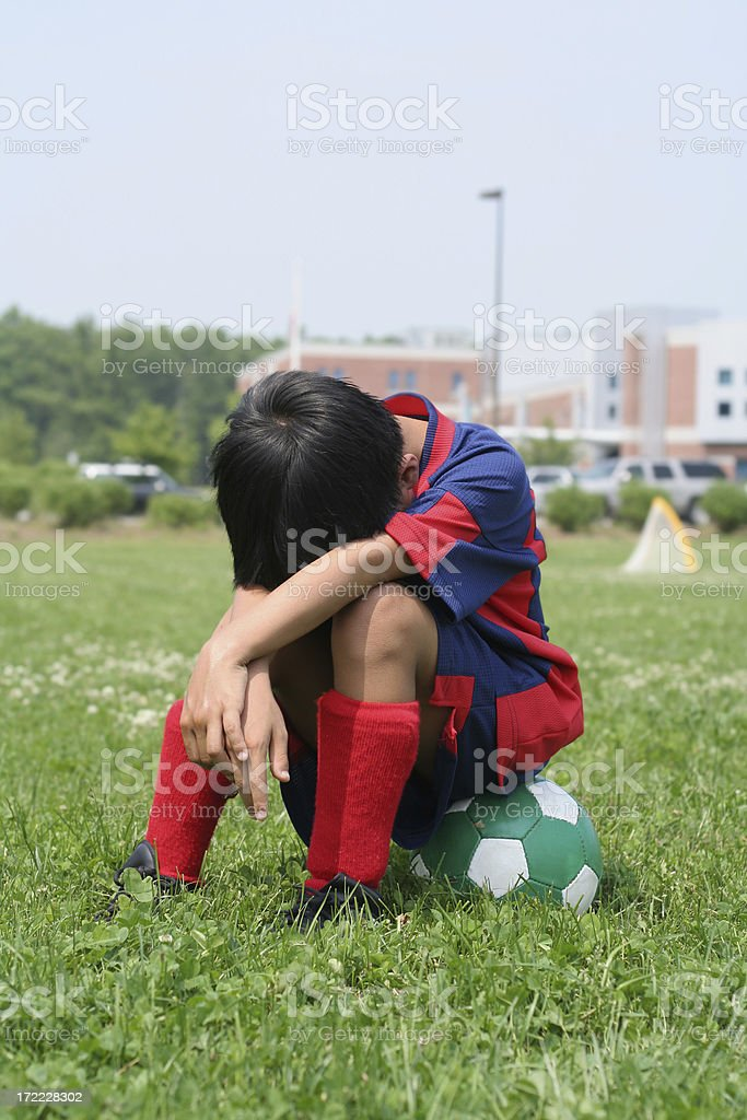 Child taking a break from soccer practice royalty-free stock photo