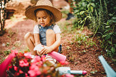 Child taking care of plants
