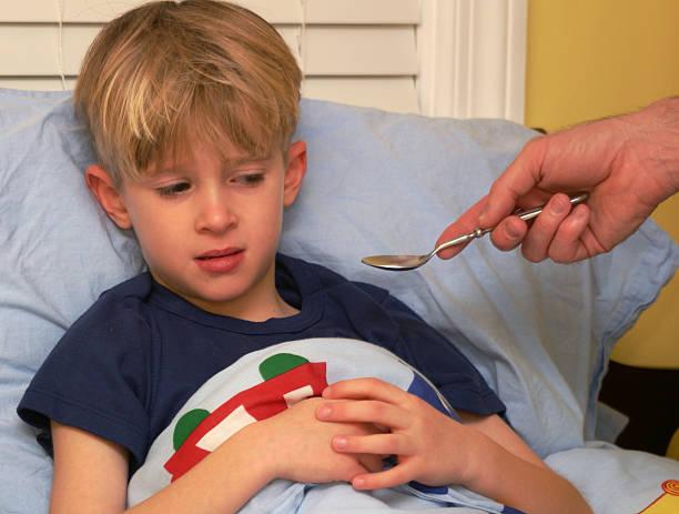child taking meds 1 stock photo