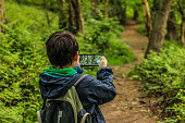 istock A child taking photos on a country footpath 1225551208