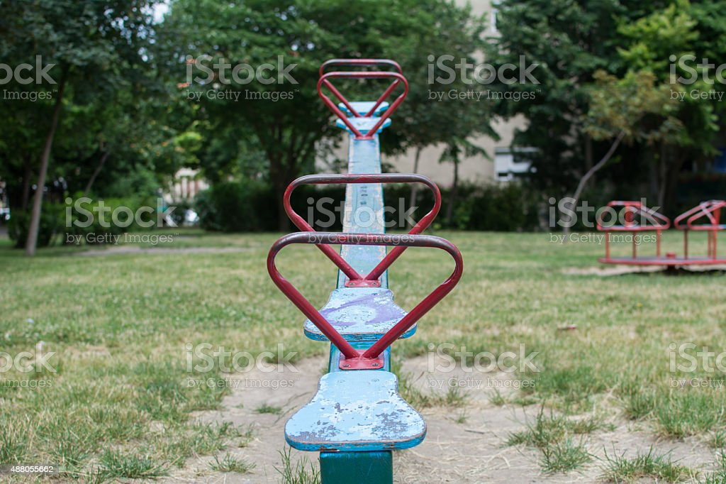 Child teeter in a park stock photo