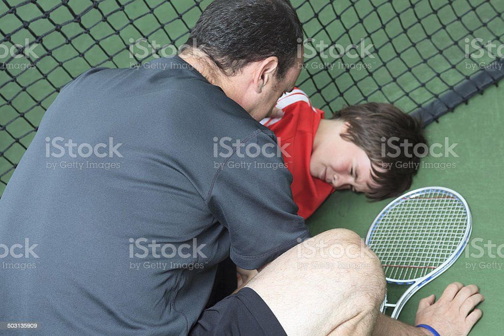 Child Tennis - Accident royalty-free stock photo