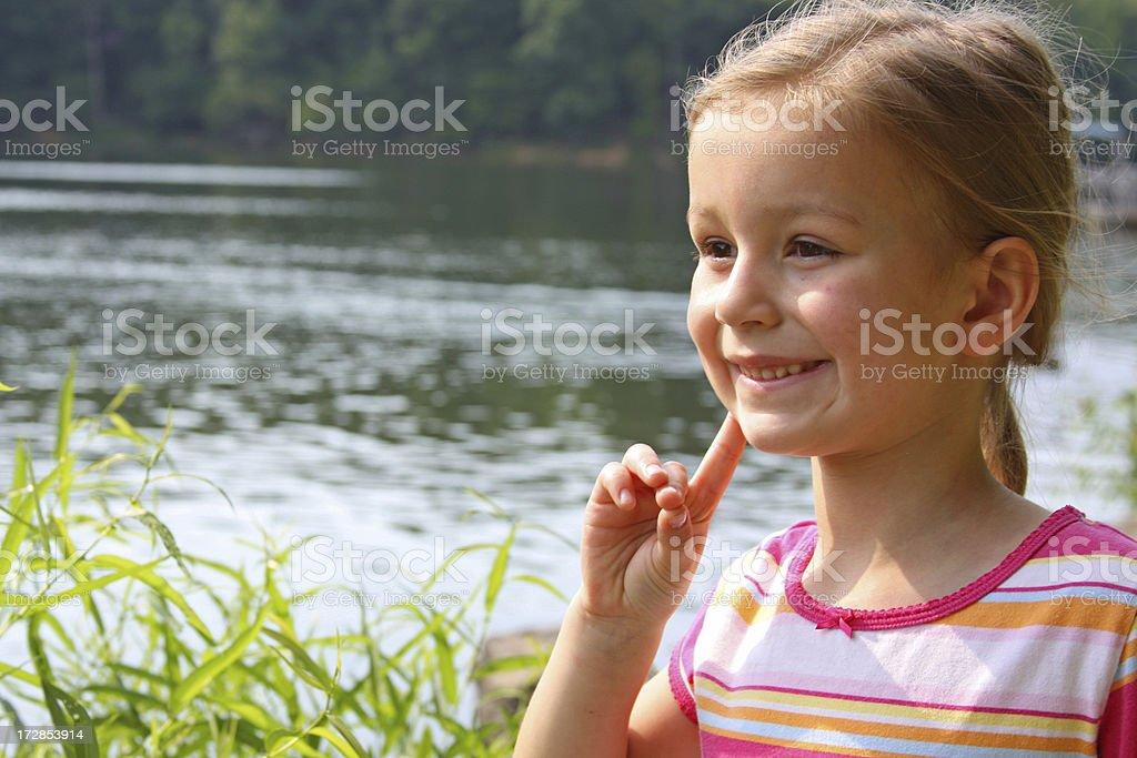 Child thinking and having idea royalty-free stock photo