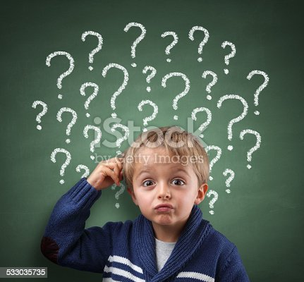 istock Child thinking with question mark on blackboard 533035735