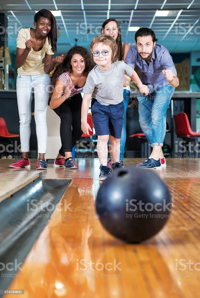 Child Throwing a Bowling Ball. stock photo