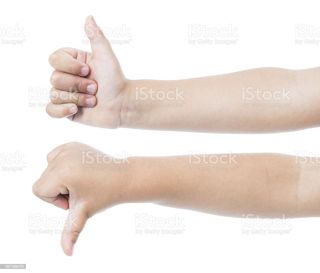 Child thumb up and down royalty-free stock photo