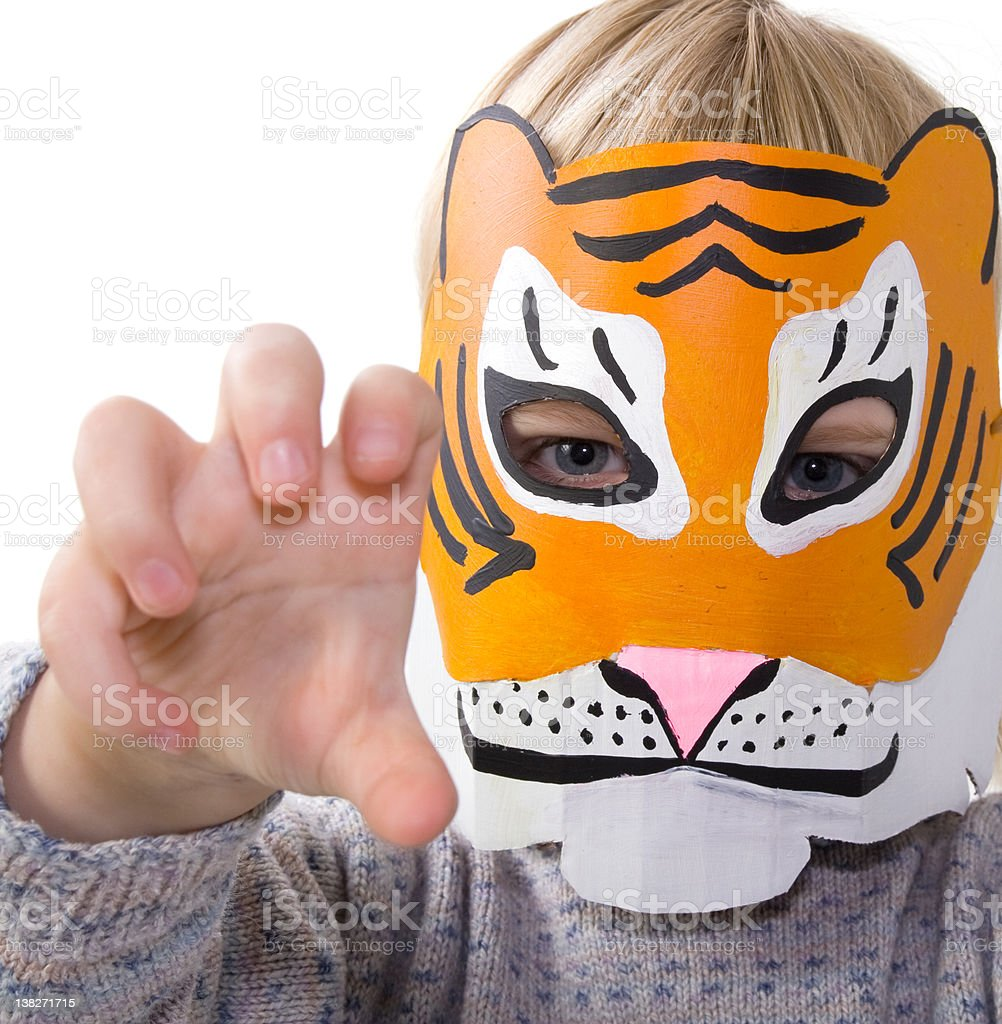 child tiger mask pretending stock photo