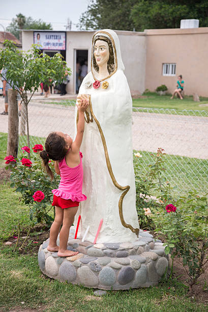 Child touches Mary the Mystical Rose stock photo