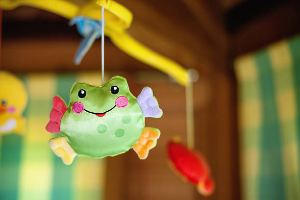 Child toy with frog hanging on baby cradle – Foto