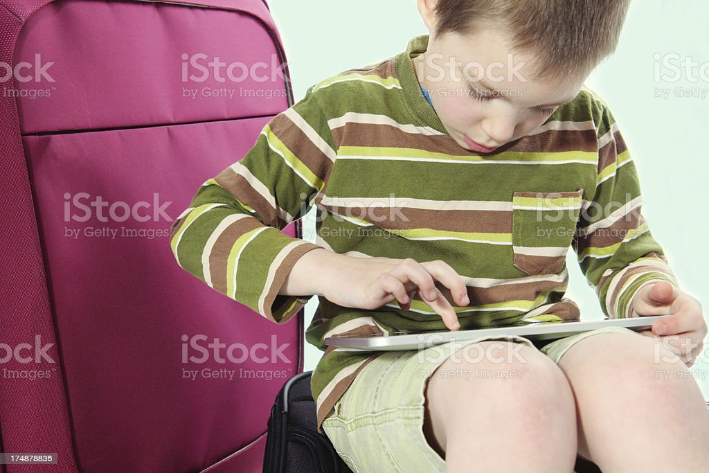 child traveling with touchpad royalty-free stock photo