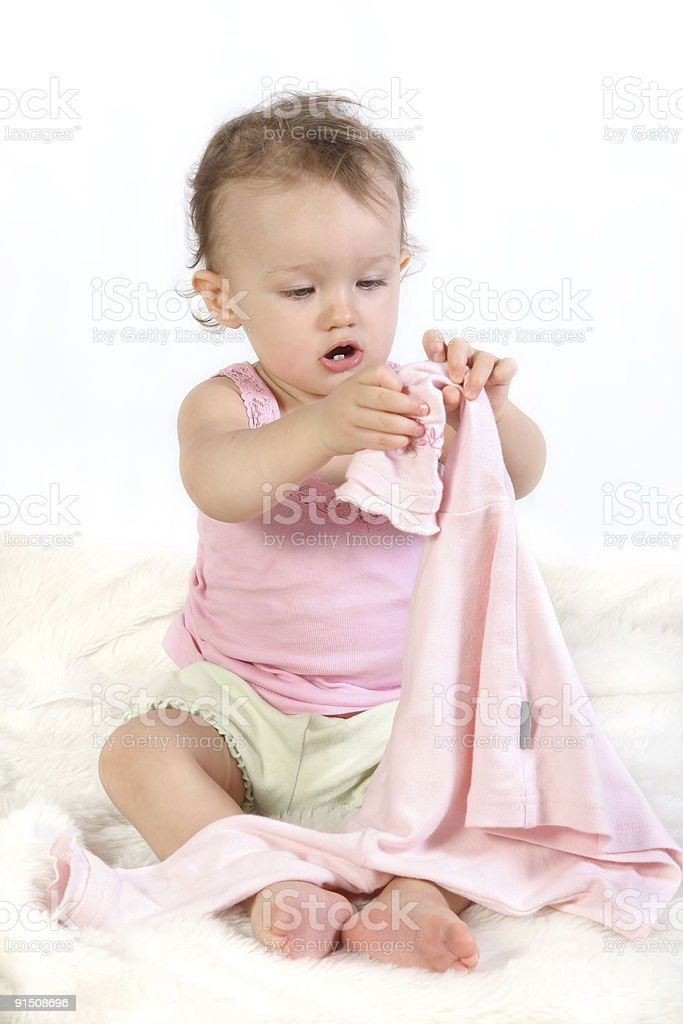 child tries to dress oneself stock photo