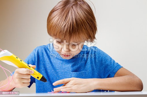 istock Child using 3D printing pen. Boy making new item. Creative, technology, leisure, education concept 655113280