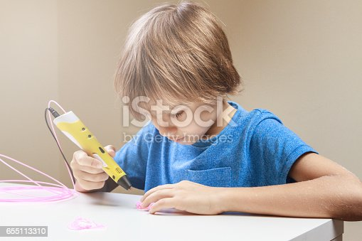 istock Child using 3D printing pen. Boy making new item. Creative, technology, leisure, education concept 655113310