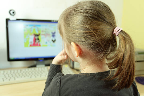 child using a computer - webcam stock photos and pictures