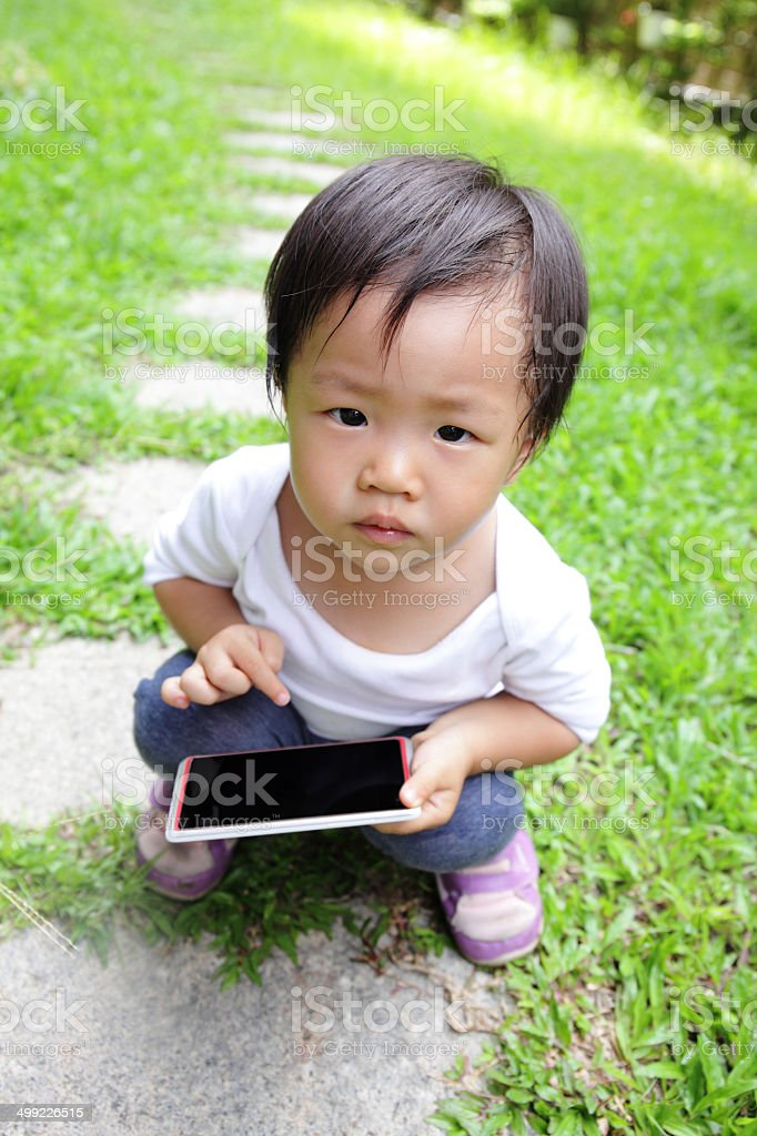 child using a digital tablet or smart phone royalty-free stock photo