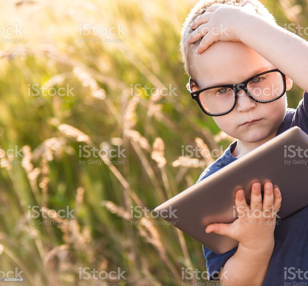 child using a digital tablet royalty-free stock photo