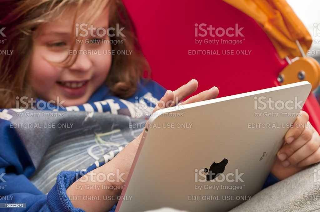 Child using an iPad royalty-free stock photo