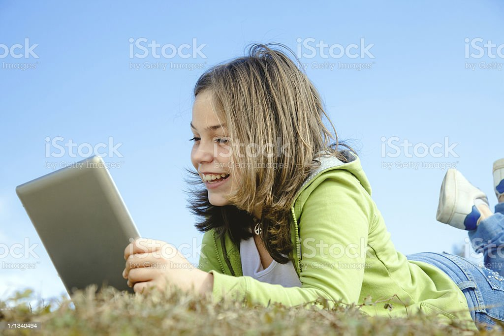 Child using digital tablet outdoors royalty-free stock photo