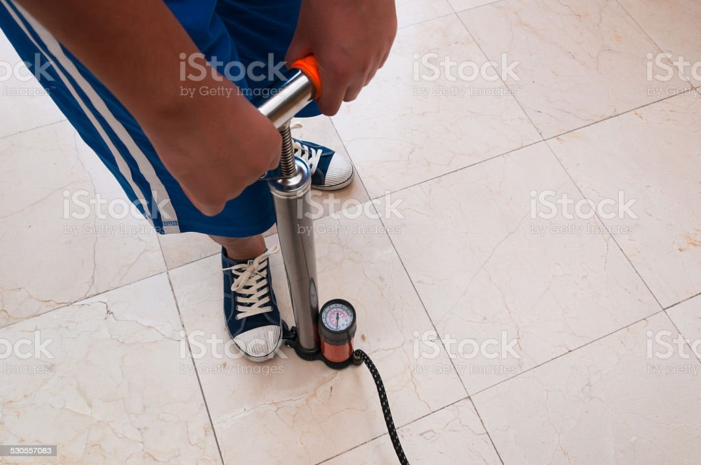 Child using foot pump isloated stock photo