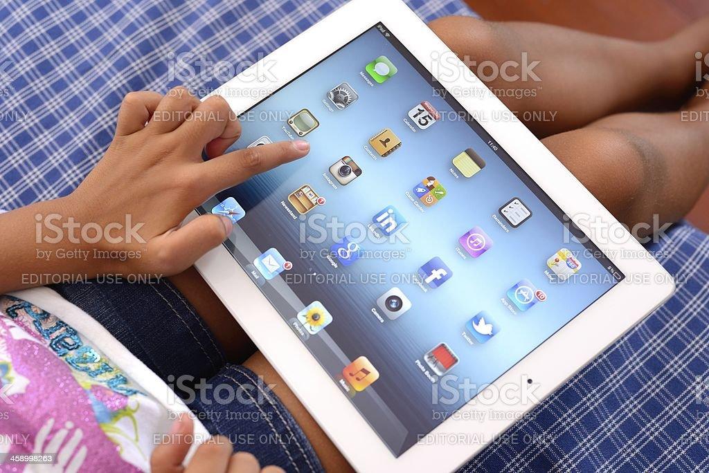 Child using iPad 3 royalty-free stock photo