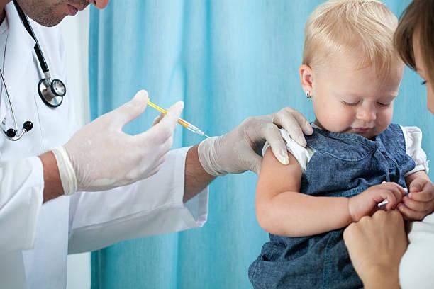 Vaccinazione bambino - foto stock