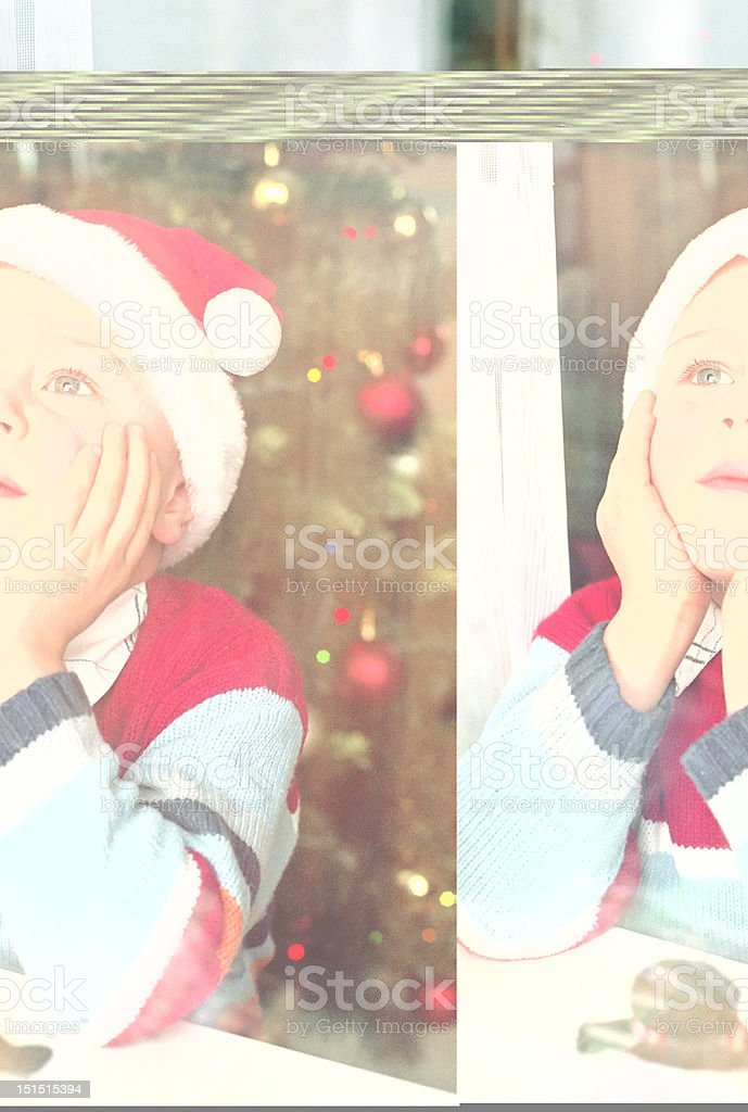 child waiting for a Santa behind window stock photo