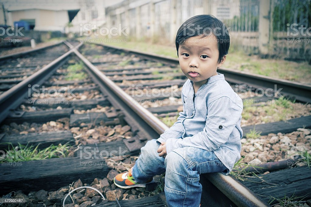 Child waiting for a train stock photo