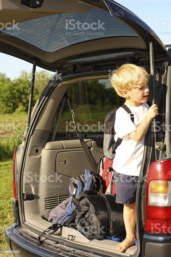 Child Waiting in Van to Leave for Vacation stock photo