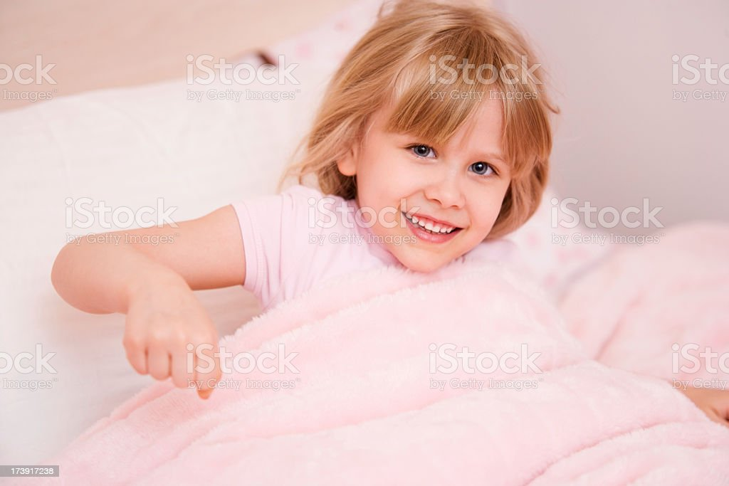 Child Waking up in Bed royalty-free stock photo