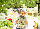 istock Child walking in the garden on sunny weather. 1257778220