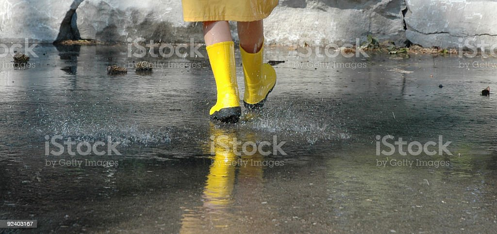 child walking in the rain royalty-free stock photo