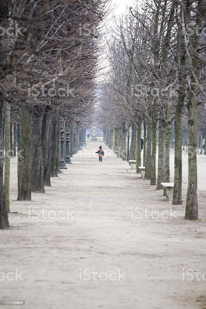 Child walking in the Tuileries Garden, Paris, France royalty-free stock photo