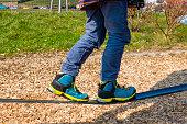 child walking on slackline