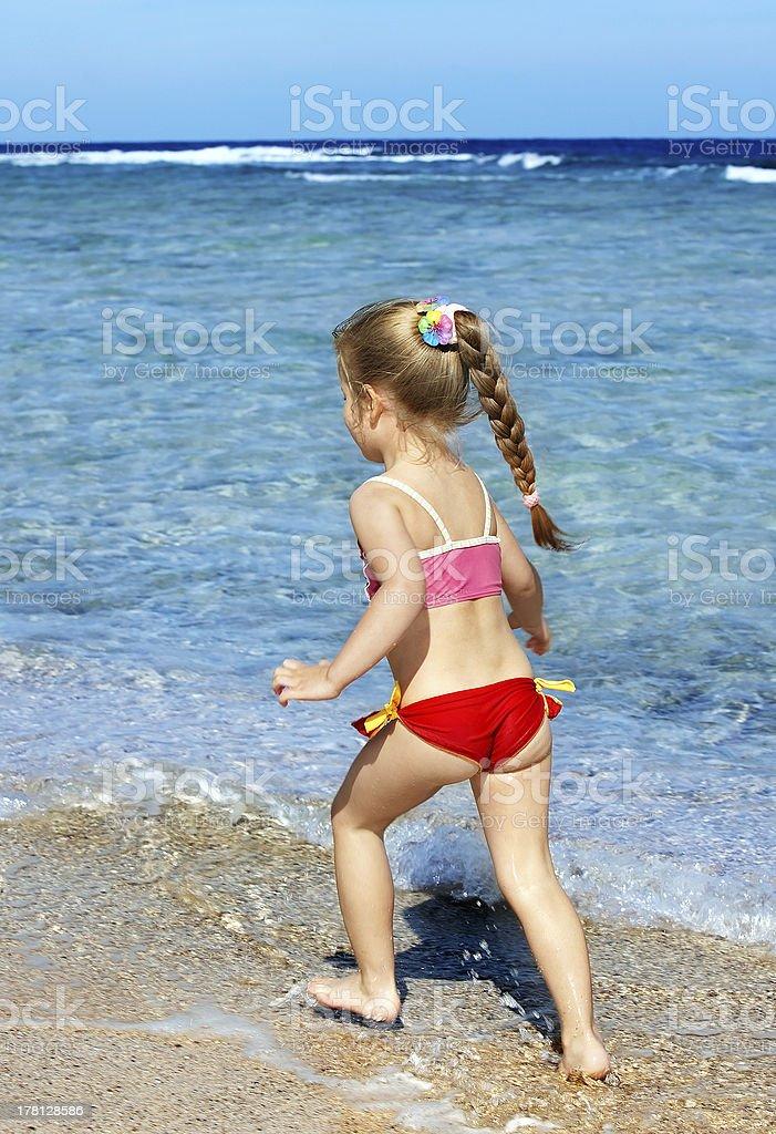 Child  walking on the beach. royalty-free stock photo