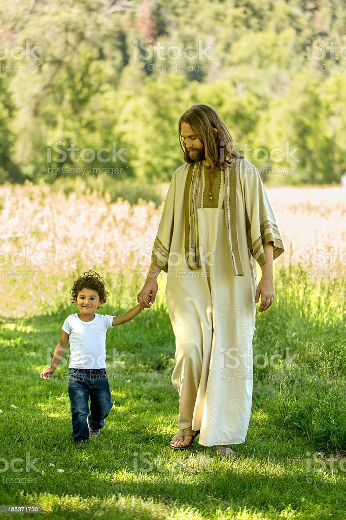 Child Walking with Jesus stock photo