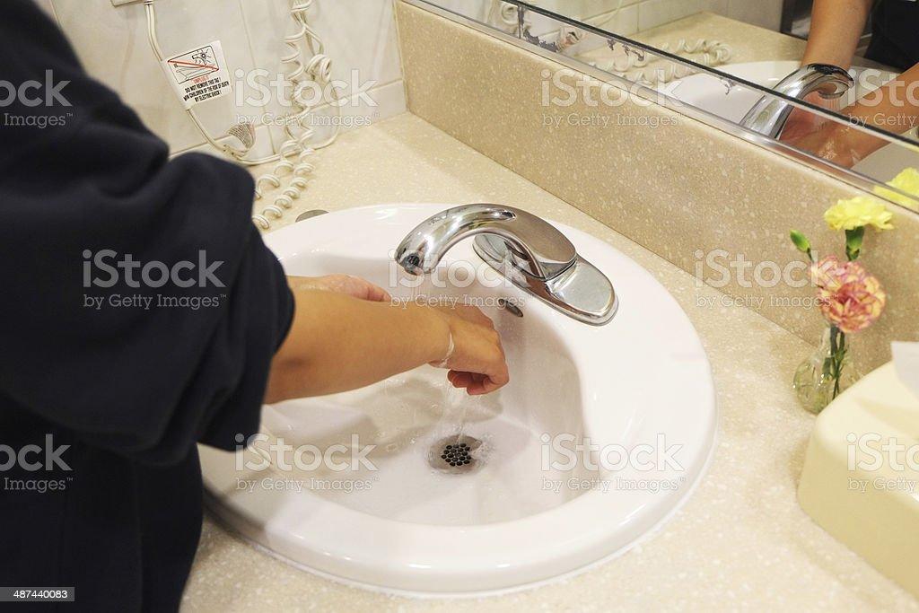 Child washing hands stock photo