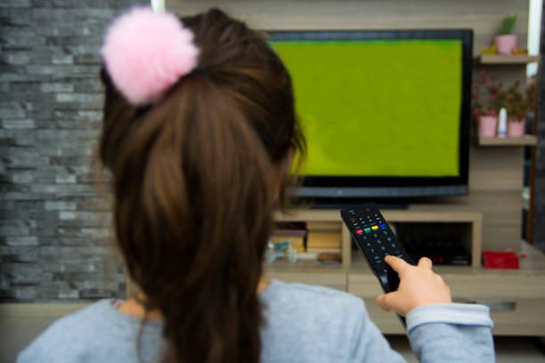 child watching cartoon stock photo