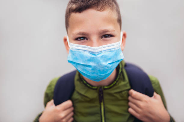Child wear facemask during coronavirus and flu outbreak stock photo
