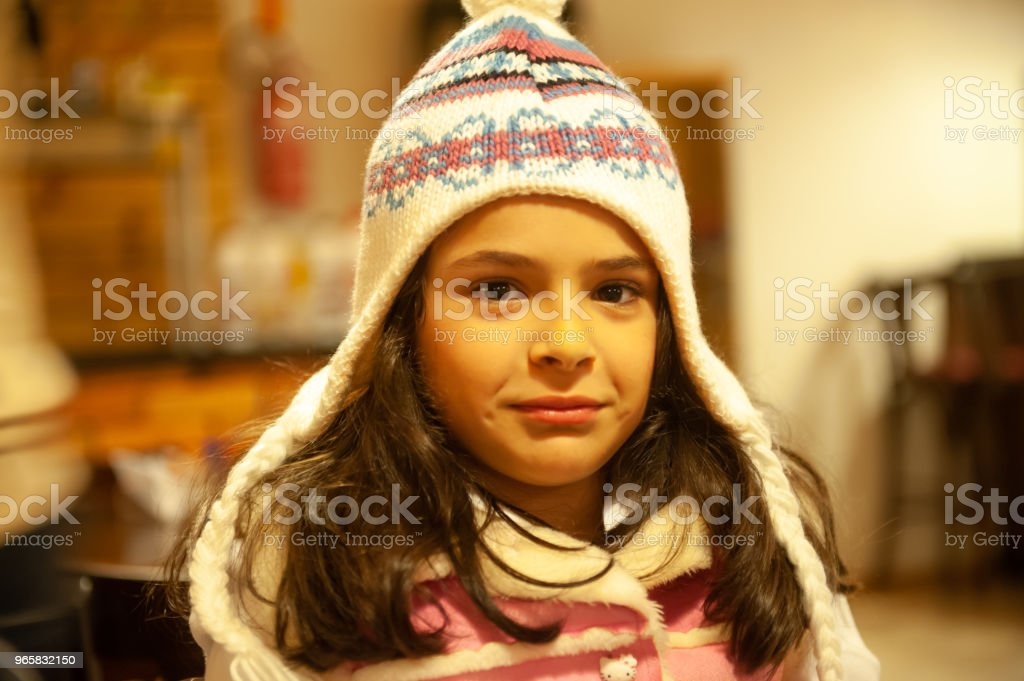 Child wearing a cap making face - Royalty-free Adult Stock Photo