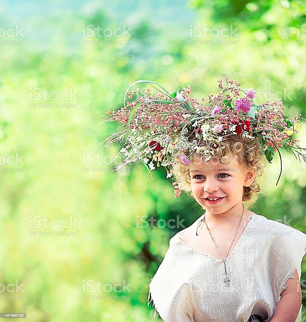 Child Wearing a Flower Wreath stock photo