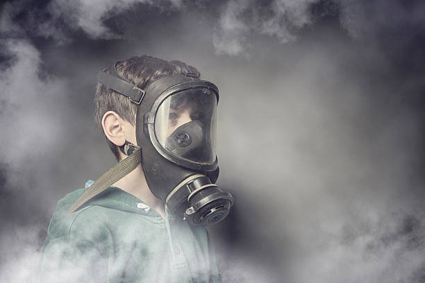 Child wearing a gas mask against air pollution - Photo